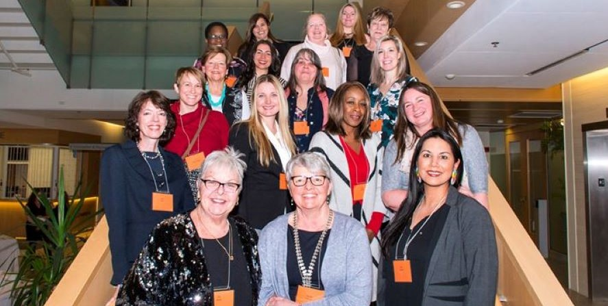 All 2019 Women of Distinction nominees stand together on a stairwell at Cambridge City Hall