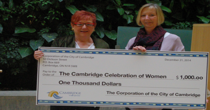 The Cambridge Symphony orchestra presents check for $1000.00 to Cambridge YWCA.