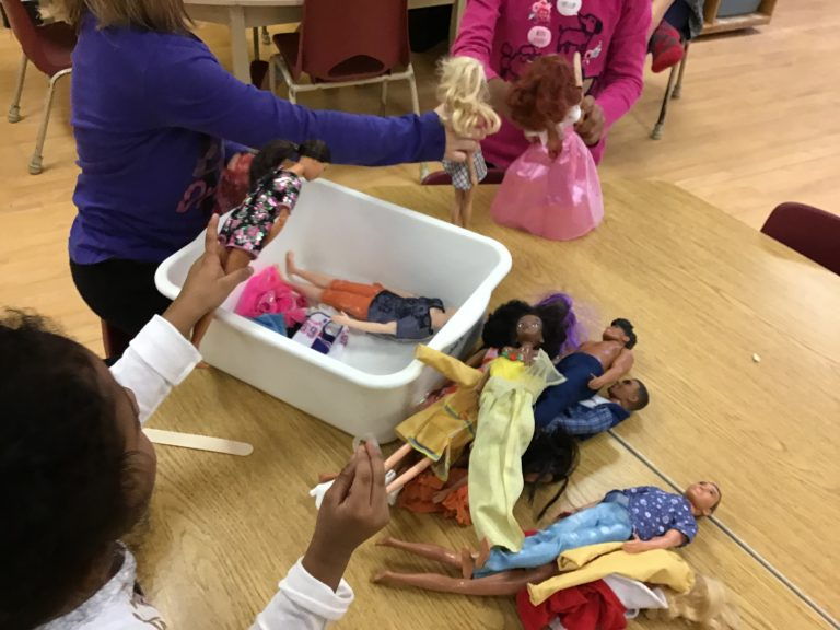 Children playing with Barbies