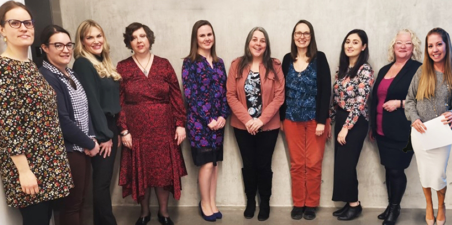 All 10 Women of Distinction 2020 nominees standing against wall