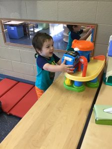 A child plays with a toy