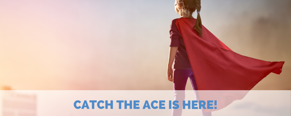 Girl in superhero cape stares off into pink sky