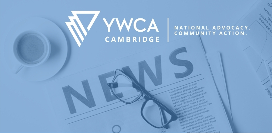 Blue filter over image of a folded newspaper with glasses sitting on top. Cup of coffee top left. YWCA Cambridge logo top centre.